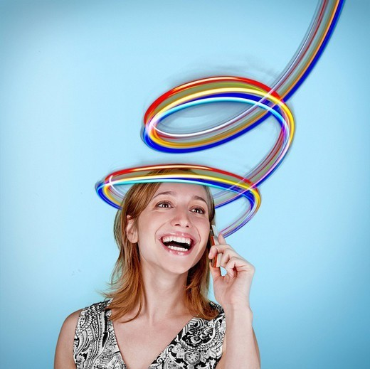 Caucasian woman talking on cell phone with colorful lines above her head : Stock Photo