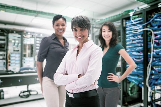 Businesswomen standing in server room : Stock Photo