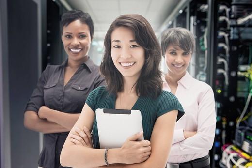 Businesswomen standing in server room : Stock Photo