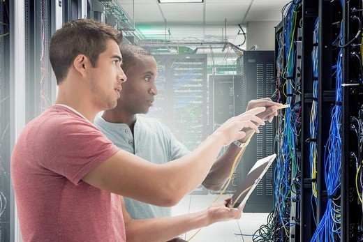 Businessmen working in server room : Stock Photo