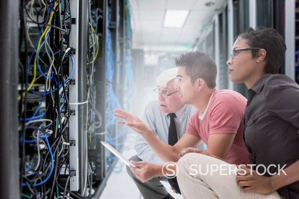 Business people working in server room : Stock Photo