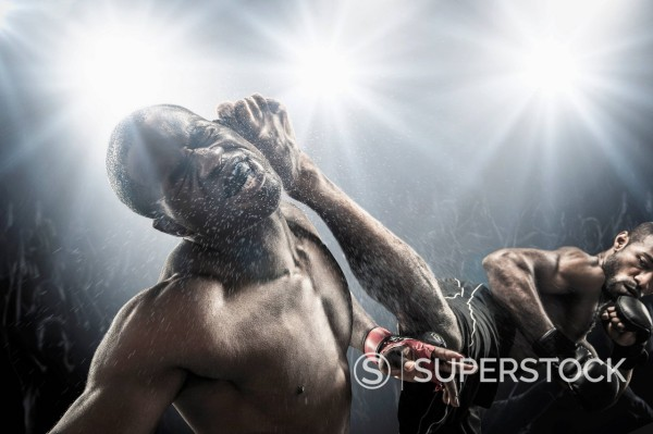 African American MMA fighters fighting : Stock Photo