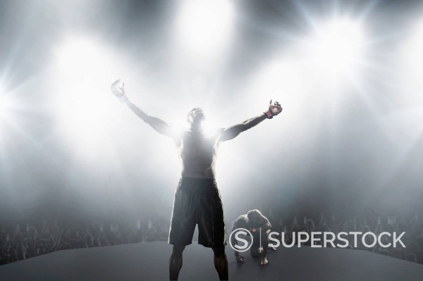 Stock Photo: 1589-170733 Light shining from behind winning African American MMA boxer