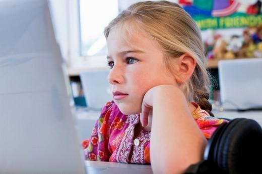 Caucasian girl using computer : Stock Photo