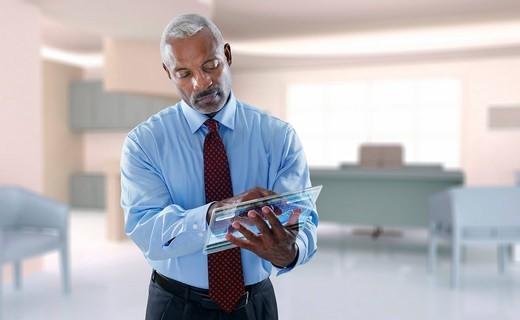 Black businessman using digital tablet : Stock Photo