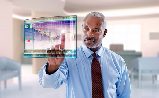 Black businessman using digital display : Stock Photo