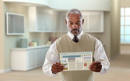 Black businessman using digital tablet in office : Stock Photo