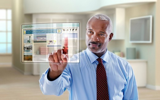 Black businessman using digital display in office : Stock Photo