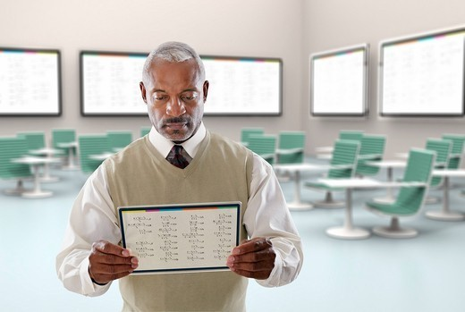Black businessman using digital tablet in conference room : Stock Photo