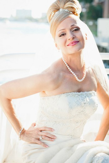 Hispanic bride with hands on hips : Stock Photo