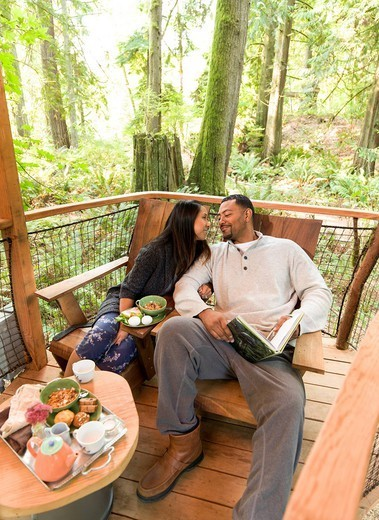 Couple relaxing together on deck : Stock Photo