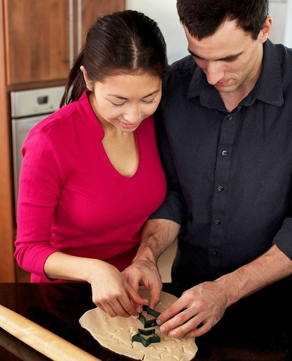 Couple baking together in kitchen : Stock Photo