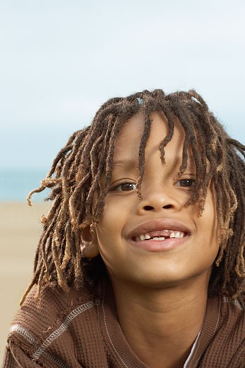 Mixed Race boy with dreadlocks : Stock Photo