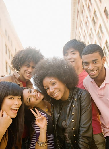 Multi_ethnic friends smiling : Stock Photo