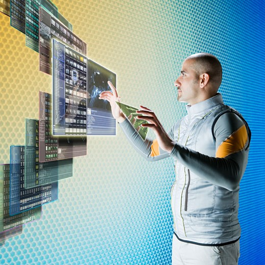 Middle eastern businessman working at futuristic control panels : Stock Photo