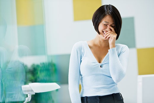 Japanese businesswoman laughing in office : Stock Photo