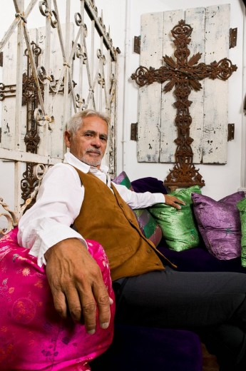 Hispanic man sitting in livingroom : Stock Photo