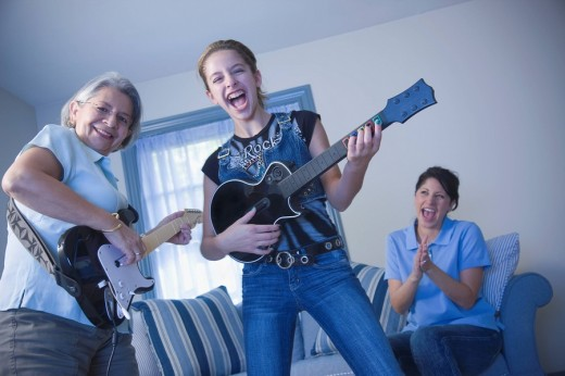 Multi_generational family playing guitars : Stock Photo