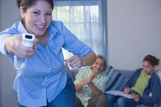 Multi_generational family playing video game : Stock Photo