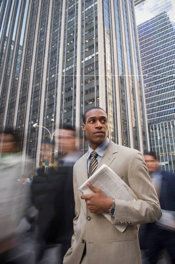 African American businessman holding newspaper : Stock Photo