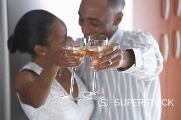 Stock Photo: 1589-68138 African couple toasting with wine