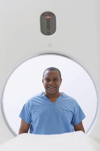 African American medical professional in front of MRI : Stock Photo