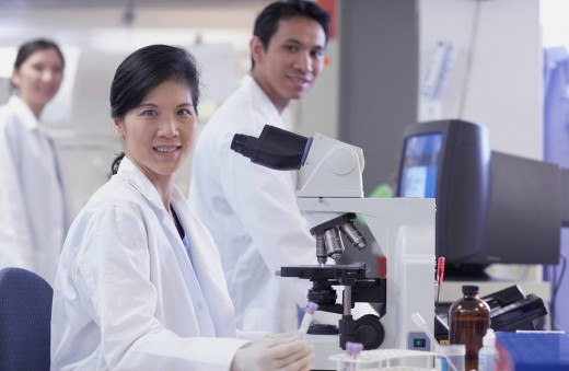 Asian scientists in laboratory : Stock Photo