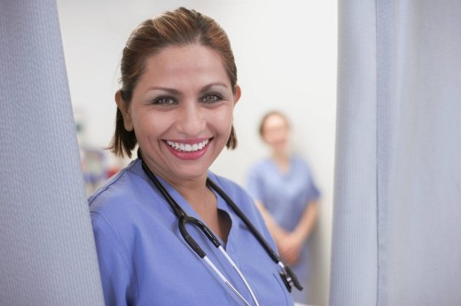 Hispanic female medical professional next to curtain : Stock Photo