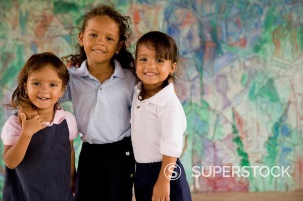 Hispanic school girls hugging : Stock Photo