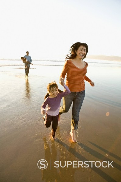 Stock Photo: 1589-74353 Hispanic family playing on beach