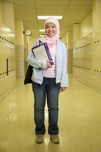 Indonesian teenager wearing headscarf in school hallway : Stock Photo