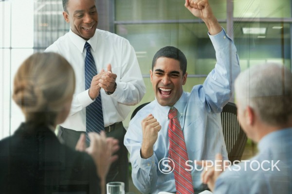 Business people celebrating in office : Stock Photo