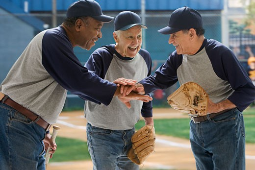 Baseball players in huddle : Stock Photo