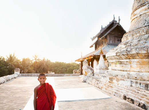 Asian boy smiling outside temple : Stock Photo