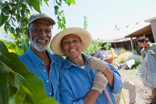 African couple doing community yardwork : Stock Photo