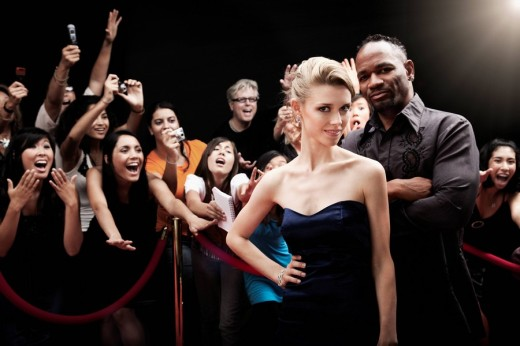 Celebrities posing on red carpet : Stock Photo