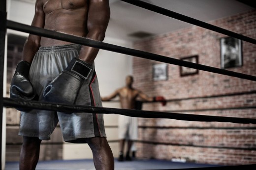 African boxer standing in boxing ring : Stock Photo