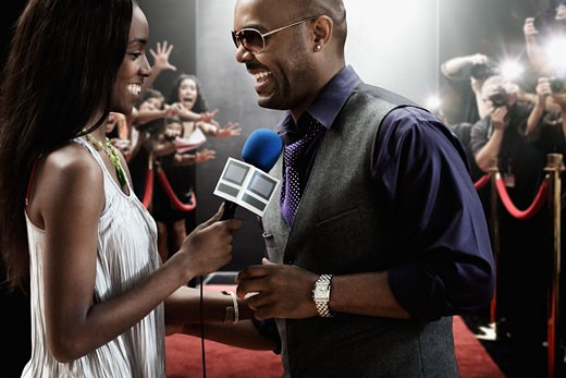 Broadcaster interviewing celebrity : Stock Photo