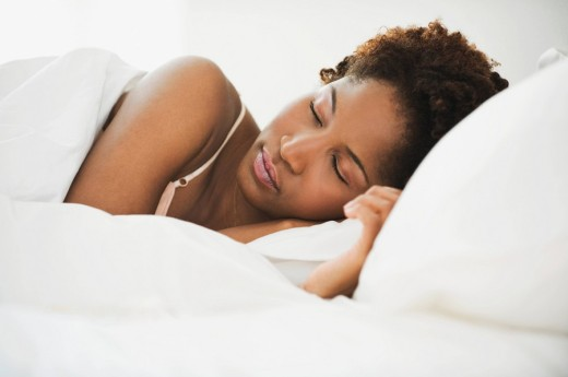 African woman sleeping in bed : Stock Photo