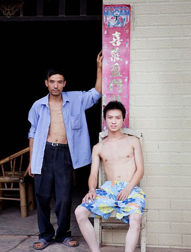 Chinese men in doorway : Stock Photo