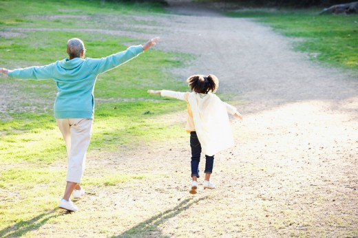 African American grandmother and granddaughter playing together : Stock Photo