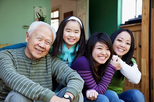 Japanese family smiling together : Stock Photo