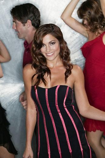 Glamorous woman dancing in nightclub : Stock Photo