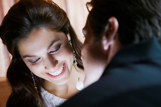 Glamorous woman smiling at husband : Stock Photo