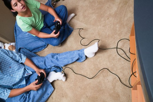 Stock Photo: 1589R-01434 Young girl and a young boy playing a video game