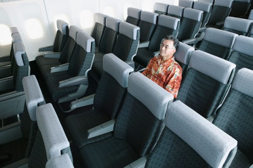 High angle view of a mature man traveling in an empty airplane : Stock Photo