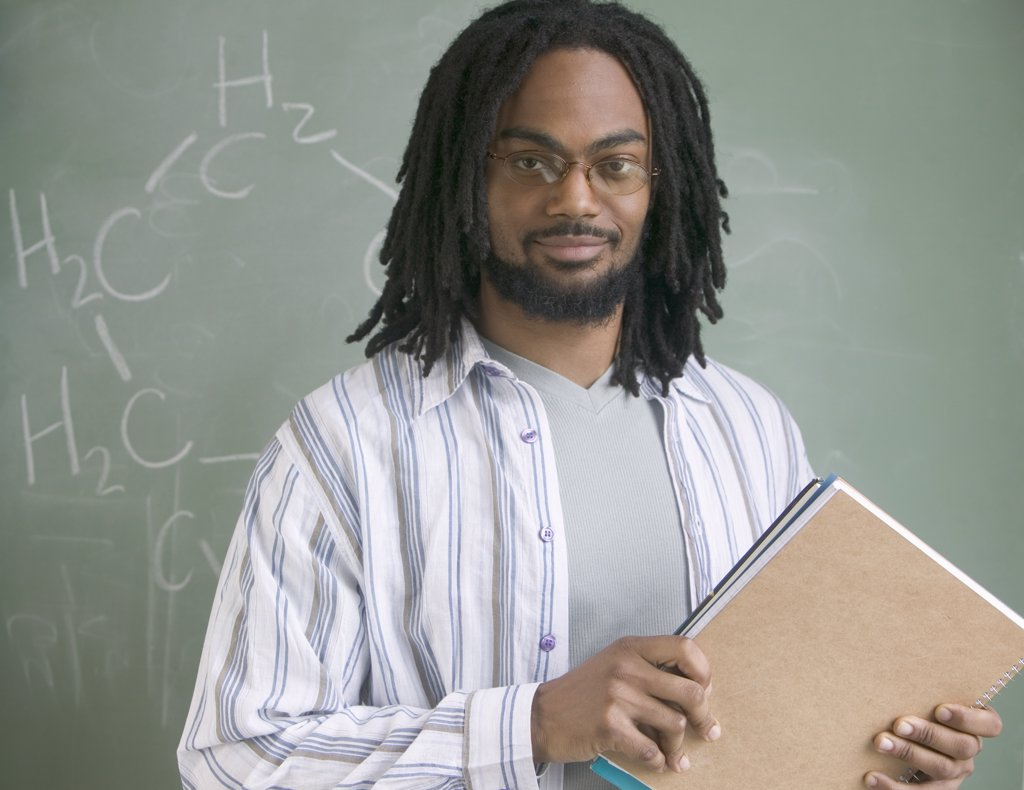 Portrait of a young male teacher : Stock Photo