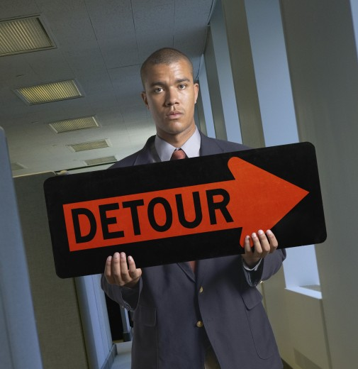 Portrait of a young man holding a signboard : Stock Photo