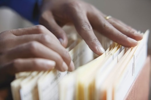 Stock Photo: 1589R-01733 Closeup of a person's hands going through files