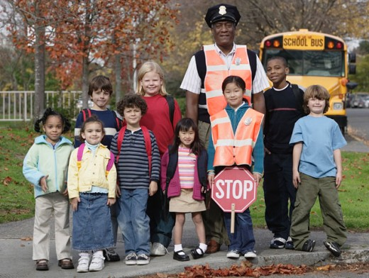Stock Photo: 1589R-01872 School Kids with Crossing Guard
